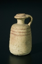 Decorated jar with handle