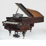 Double grand piano with reversed keyboard